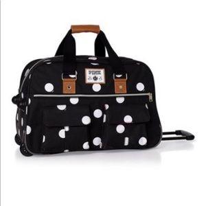 Pink Victoria secret rolling duffel bag suitcase